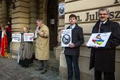 KRAKOW, POLAND - MAR 9, 2014: Unidentified participants during protest near Cracow Opera, against br