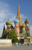MOSCOW, RUSSIA - JULY 8, 2008: People walks near St. Basil's Cathedral on Red Square. The Cathedral