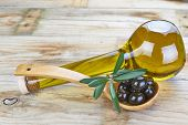 Smart Bottle Of Olive Oil And Spoon With Olives