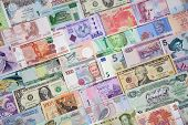 stock photo of money  - Background from paper money of the different countries - JPG