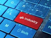 Business concept: Gears and Industry on computer keyboard background