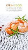 Roasted tails of shrimps with fresh rosemary