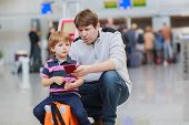 Father And Little Son At The Airport