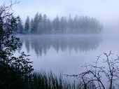 Morning mist on a mountain lake.