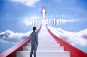 The word satisfaction and businessman standing against red steps arrow pointing up against sky