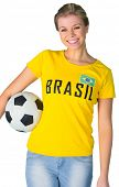 Pretty football fan in brasil tshirt on white background