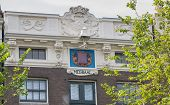Typical Amsterdam Canal House With Cornices