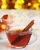 Hot christmas drink with cinnamon sticks