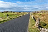 Empty Road Running Through Donegal Coast