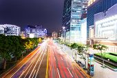 Car light trails and urban landscape in modern city