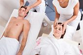 Young Couple Enjoying Massage