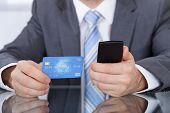 Businessperson Using Phone Card