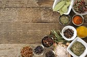 different spices on a wooden table background