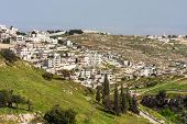 Palestinian town on suburb of Jerusalem and West Bank israeli separation barrier on background.