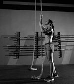 picture of climb up  - Rope Climb exercise woman workout at gym climbing - JPG