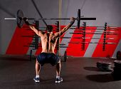 stock photo of barbell  - barbell weight lifting man rear view back workout exercise at gym box - JPG