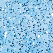 Disassembled Blue Puzzle Pieces Closeup