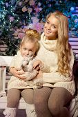 Winter mother and daughter. Smiling beauty woman and child. Cute girl with kid.