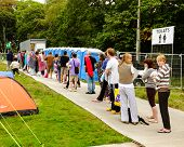 People queuing to use campsite showers.