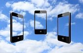 Three Modern Mobile Phones On The Sky