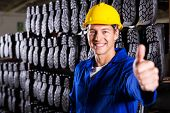 cheerful gumboot factory worker giving thumb up