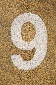 Number Nine Sign On Sand Fome