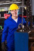 good looking male industrial repairman in workshop