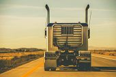 foto of tractor-trailer  - Tractor Trailer on the Highway - JPG