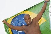 African man holding up beach wrap