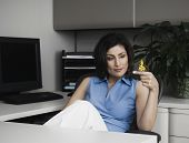Hispanic businesswoman with butterfly on finger
