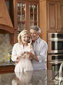 Multi-ethnic couple shopping on telephone