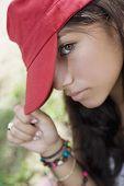 Hispanic teenaged girl wearing hat