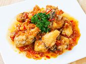 picture of grouper  - Close up deep fried grouper fish spicy sweet and sour sauce - JPG