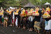BALI, INDONESIA - SEPTEMBER 19, 2014: Families gather at the beach bringing offerings for the Nyaben