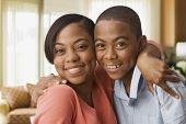 stock photo of pre-adolescent child  - African mother hugging son - JPG