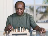 Senior African man playing chess