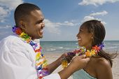 African couple wearing leis