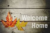 Welcome Home Written On Vintage Wooden Background