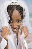 African bride pulling veil forward