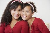 stock photo of identical twin girls  - African twin sisters hugging - JPG