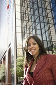 Indian businesswoman in front of high-rise