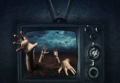 stock photo of zombie  - Zombie hand coming out of TV - JPG