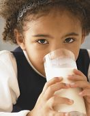 African girl drinking glass of milk