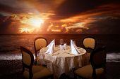 Evening beach dinner serving in sunset light