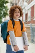 Mixed Race boy carrying laptop
