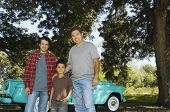 Multi-ethnic family in front of truck