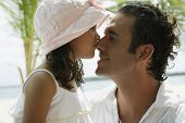 Hispanic girl kissing father on nose