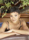 African American woman wearing hoop earrings