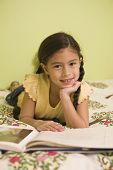 Pacific Islander girl reading book