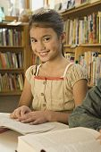 stock photo of pacific islander ethnicity  - Pacific Islander girl in library - JPG